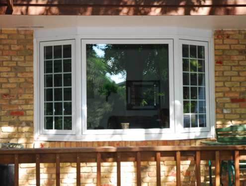 Vinyl replacement windows uhlmann home improvement for Vinyl bay window